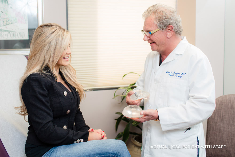 Dr. Brahme in consultation with a breast implant patient